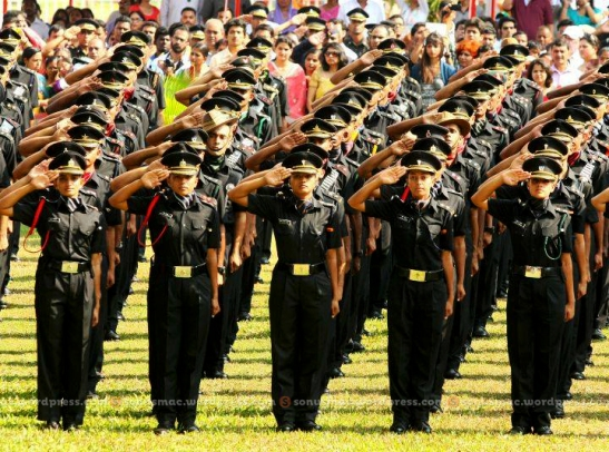 Newly commissioned officers saluting for the first time to samman toli.