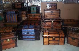 room full of Army trunks