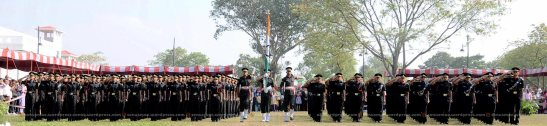 Young officer saluting the Tricolor (Indian-flag)